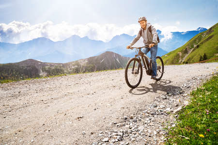 Photo for Man Riding Electric Mountain Bike In Alps - Royalty Free Image