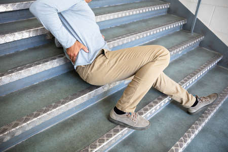 Photo for Mature Man Lying On Staircase After Slip And Fall Accident - Royalty Free Image