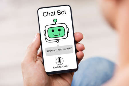 Photo pour Close-up Of Man Using Chat Bot Application For Chatting On Smartphone - image libre de droit