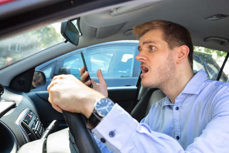 Photo pour Driver Had Almost Accident While Using Phone While Driving Car - image libre de droit