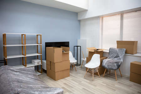 Photo pour Living Room Interior Of New House With Moving Boxes - image libre de droit