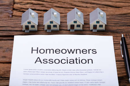 Foto de House Model Near HOA Rules And Regulations Document - Imagen libre de derechos