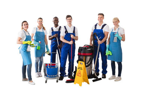 Photo pour Diverse Group Of Professional Janitor Standing With His Cleaning Equipment Against White Background - image libre de droit