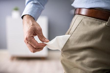 Photo pour Close-up Of Young Man Showing Empty Pockets - image libre de droit