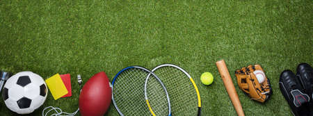Photo pour High Angle View Of Various Sport Equipment On Green Grass - image libre de droit