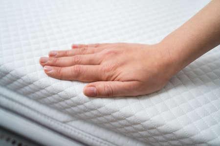 Photo pour Hand Testing Orthopedic Memory Foam Core Mattress - image libre de droit