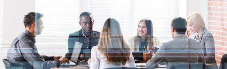 Photo pour Happy Business Team In Office At The Meeting - image libre de droit
