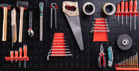 Photo pour Toolkit Tools On Metal Board In Garage - image libre de droit