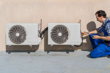 Photo for Man Doing Heating, Ventilation, And Air Conditioning Inspection - Royalty Free Image
