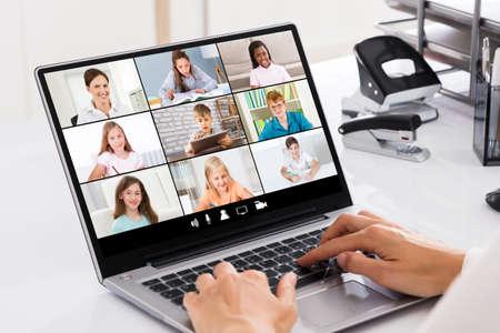 Photo pour Teacher Hosting Online Class Using Video Conference On Laptop - image libre de droit