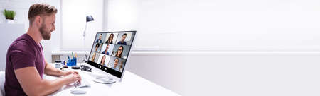Photo pour Work From Home Video Conferencing On Computer - image libre de droit
