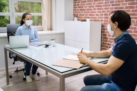 Photo for Job Interview Business Meeting At Law Office Wearing Face Mask - Royalty Free Image