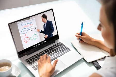 Photo pour Woman Participating In Online Coaching Session Using Laptop - image libre de droit