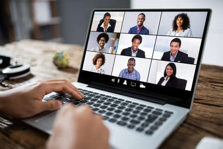 Photo pour Man Working From Home Having Online Group Videoconference On Laptop - image libre de droit