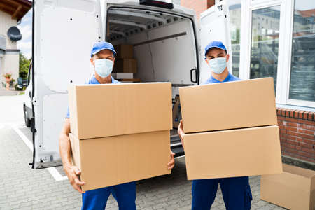 Photo for Furniture Move And Removal Using Truck Or Van With Face Mask - Royalty Free Image