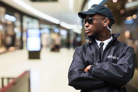 Photo for Security Guard Officer Standing In Shopping Mall - Royalty Free Image