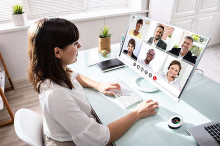 Photo pour Woman In Video Conference Business Call. Videoconference Meeting - image libre de droit