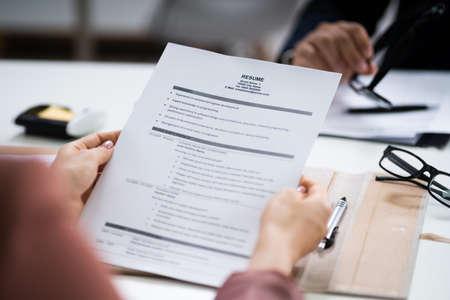 Photo pour Reading Resume And Recruitment Application At Job Interview - image libre de droit