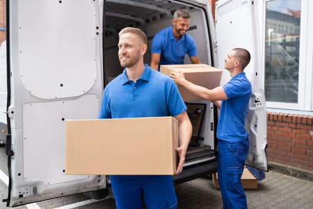 Photo for Truck Movers Loading Van Carrying Boxes And Moving House - Royalty Free Image