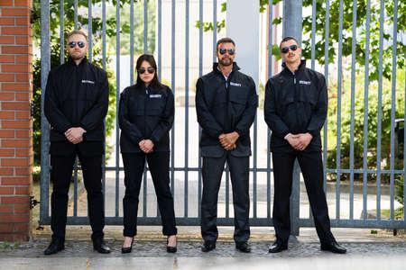 Photo pour Security Guard Officer Group At Event Entrance Gate - image libre de droit