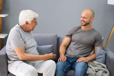 Photo pour Grandpa Talking To His Grandson In Living Room - image libre de droit