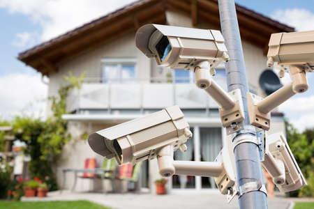 Photo pour CCTV Security Video Cameras Watching Private House - image libre de droit