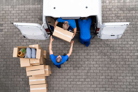 Photo for Open Truck Delivery. Mover Men Moving Boxes - Royalty Free Image