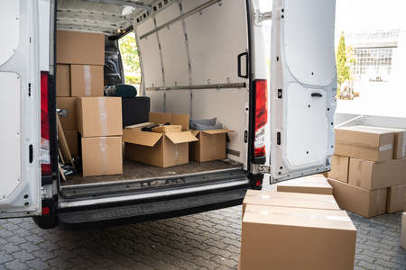 Photo for Van With Boxes On Street From Relocation Service Business - Royalty Free Image
