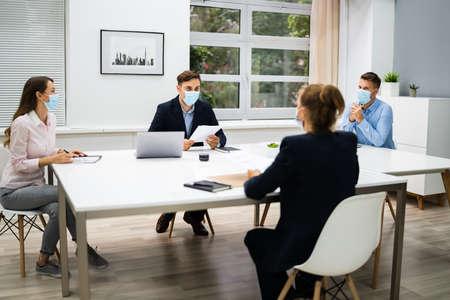 Photo pour Job Interview Business Meeting At Law Office Wearing Face Mask - image libre de droit