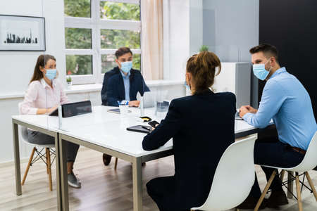 Foto de Face Mask Office Social Distancing Meeting Or Interview - Imagen libre de derechos