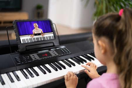 Foto de Music Piano Internet Class At Home. Studying Online - Imagen libre de derechos