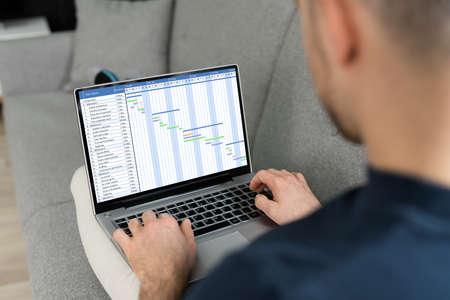 Photo pour Business Report Time Sheet Gantt Schedule On Computer - image libre de droit
