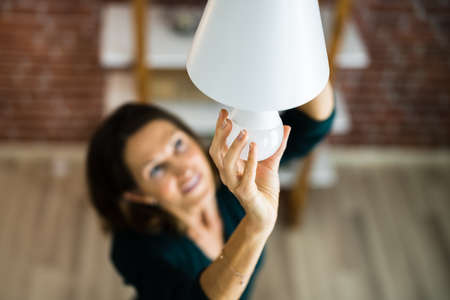 Photo for Electric LED Lightbulb Change In Light At Home - Royalty Free Image