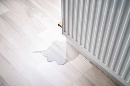 Photo for Laminate Floor Damage In Room After Heating Pipe Leakage - Royalty Free Image
