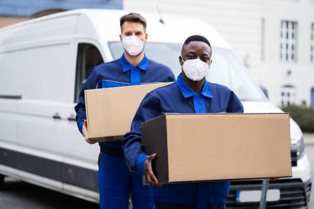Photo for African American Movers Service Man In Face Mask - Royalty Free Image