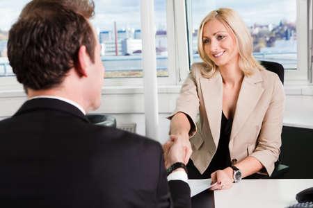 Foto de Two businesspeople at an interview in the office - Imagen libre de derechos