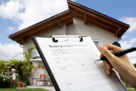 Photo pour African American Inspector Checking Building Inspection Report - image libre de droit