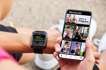 Photo for Internet Sport Mobile Phone App. Fitness Exercise Technology - Royalty Free Image