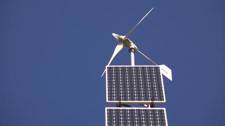 Photo pour Solar panel and wind turbine on the sky background - image libre de droit