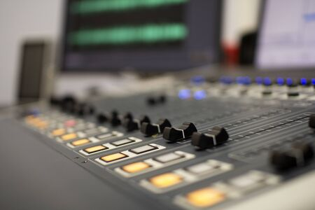 Photo for Professional audio mixing console with faders and adjustment knobs. - Royalty Free Image