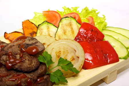 Grilled meat with fried vegetable salad