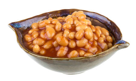 Marinated haricot beans in tomato sauce with shallots on a plate