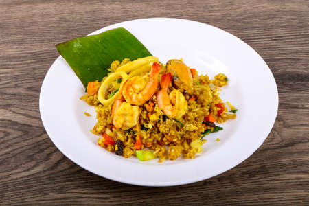 Fried rice with seafood - shrimp, mussel, squid