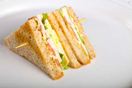 Photo for Club sandwich with meat, cheese and vegetables - Royalty Free Image