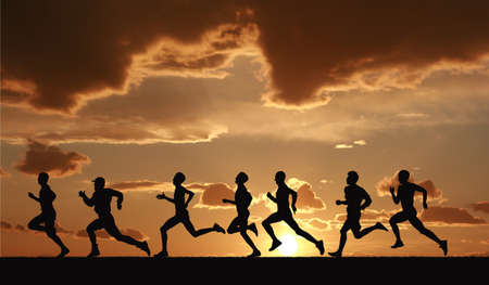 Foto de Marathon, black silhouettes of runners on the sunset - Imagen libre de derechos