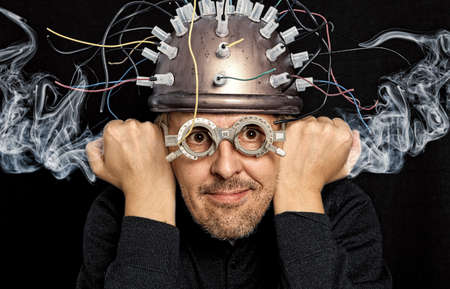 Photo for Crazy inventor with helmet for brain research - Royalty Free Image