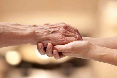 Photo pour Female hands touching old male hand - taking care of the elderly concept - image libre de droit