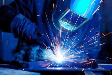 Foto de Welder erecting technical steel. Industrial steel welder in factory technical - Imagen libre de derechos