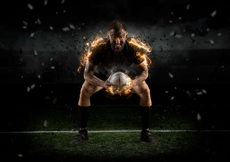 Photo for Rugby player in action on dark arena - Royalty Free Image