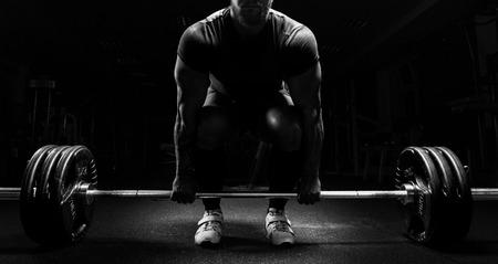 Photo pour Huge man is preparing to perform an exercise called deadlift. Mixed media - image libre de droit